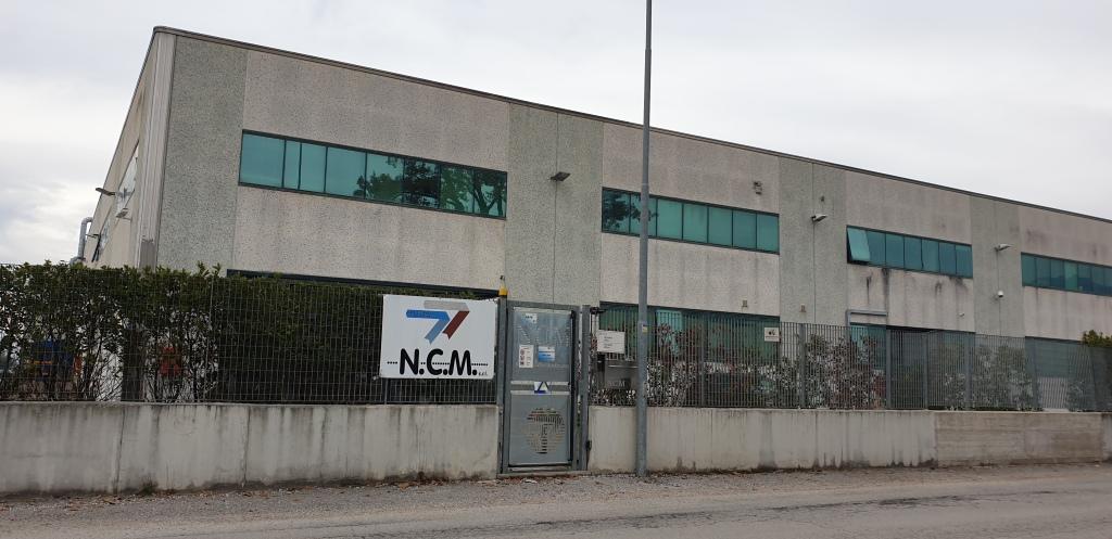 In foto: l'ingresso dello stabilimento NCM, di Francesca Romana Felici