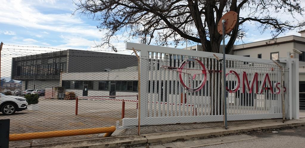 In foto: l'ingresso dello stabilimento OMA, di Francesca Romana Felici